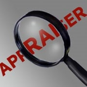 Appraiser with magnifying glass